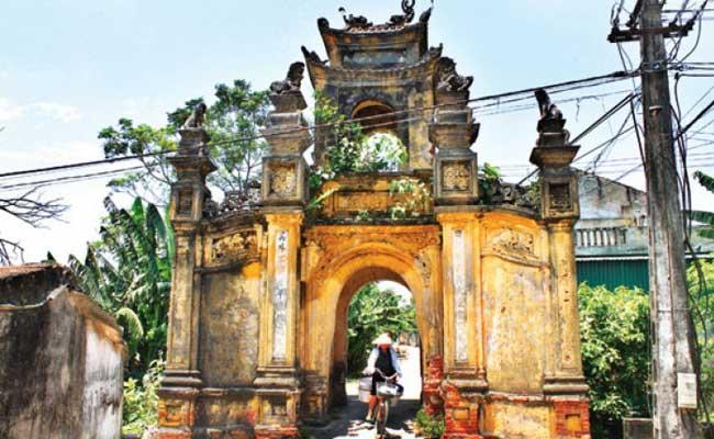 village cuu portique entree visiter hanoi