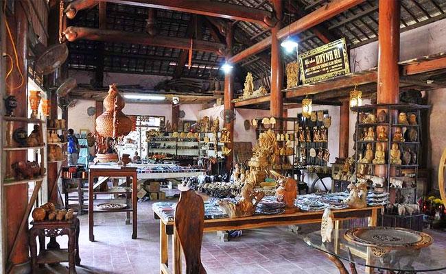 visiter hoi an village artisanal bois exposition